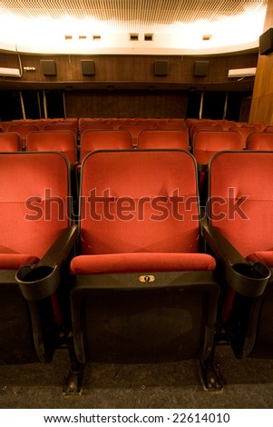 red chairs in the cinema - stock photo