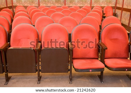 red chairs in the empty small cinema auditorium - stock photo