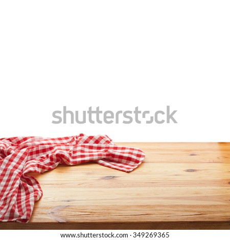 Red checked tablecloth on wooden deck table on white background. Mockup for design