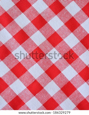 red checkered fabric closeup , tablecloth texture  - stock photo