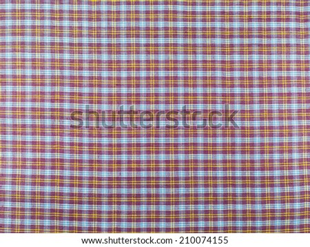 red checkered fabric tablecloth - stock photo