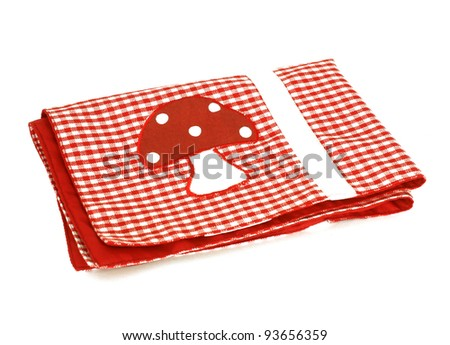 red checkered picnic cloth with applique,  isolated on white background - stock photo