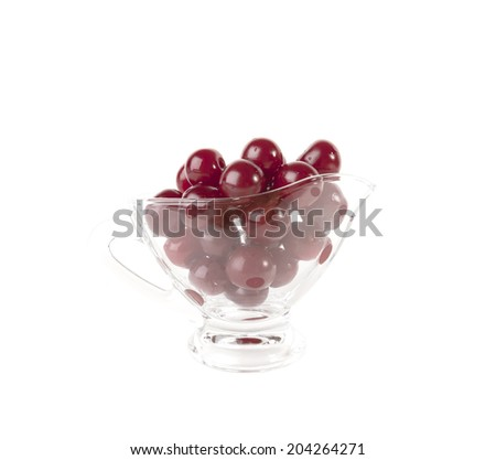 Red cherries in glass vase isolated on white background - stock photo
