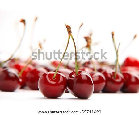 Red cherries on white background - stock photo