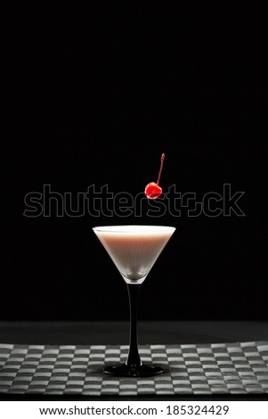 red cherry falling in to a glass - stock photo