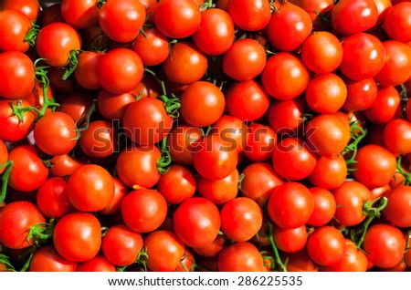 Red Cherry tomatoes in market close up, may use as background. 
