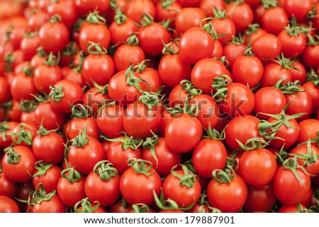 Red cherry tomatoes pattern. - stock photo