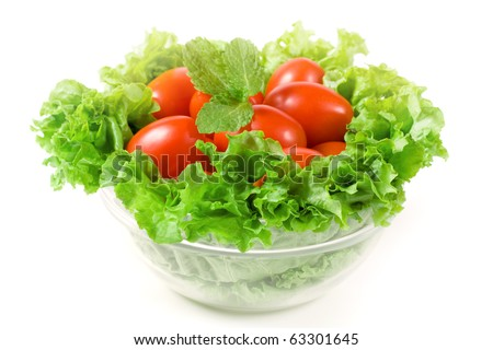 Red cherry tomatoes with green lettuce