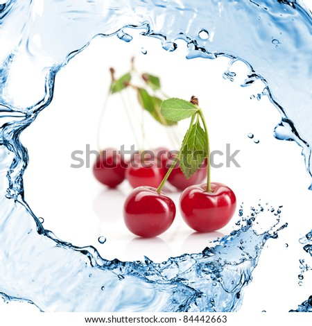 Red cherry with leaves and water splash isolated on white - stock photo