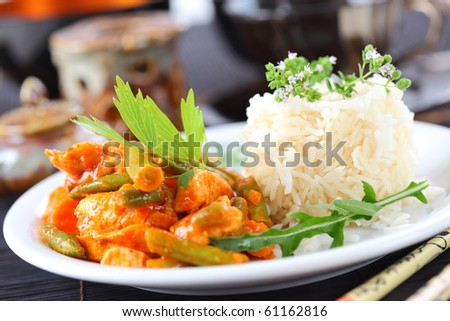 Red chicken curry stripes with rice and vegetable - stock photo