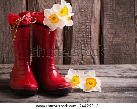 red child garden shoes with spring flowers - stock photo