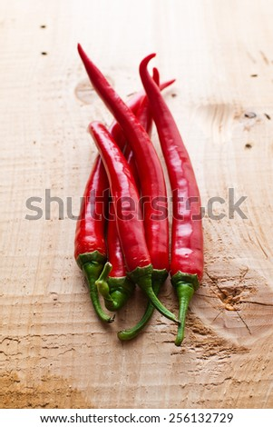 Red chili on wooden background. - stock photo