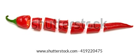 Red chili pepper cut into slices isolated on white background - stock photo