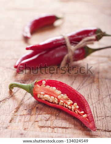 red chili pepper on wooden table. Selective focus - stock photo