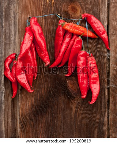 Red Chili Peppers hanging outdoor - stock photo