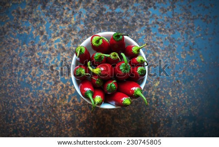 Red chili peppers in a white bowl - stock photo