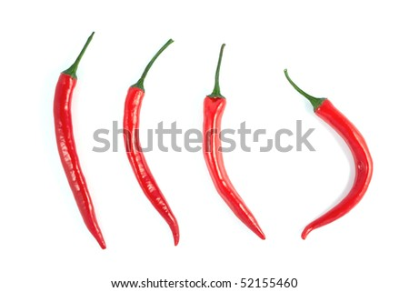 Red chili peppers on a white background - stock photo