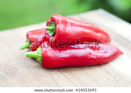 Red Chili Peppers over wooden background - stock photo