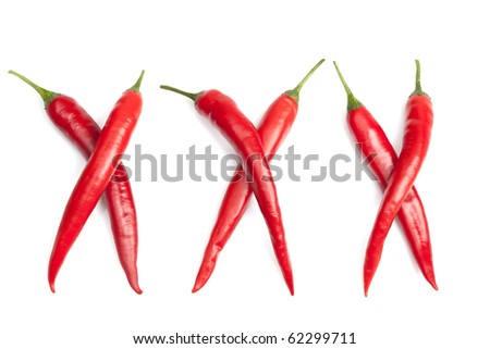 Red chili peppers spelling XXX - stock photo