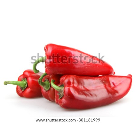 Red chilli peppers on white background - stock photo