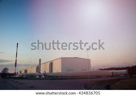 Red chimney and white buildings. - stock photo