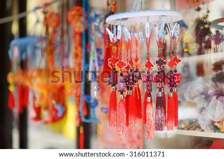 Red chinese decorations in Chinatown in New York city, USA - stock photo