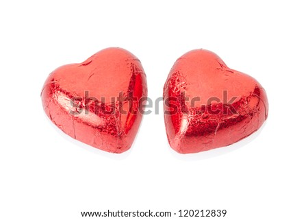 Red chocolate hearts isolated on white, clipping path included - stock photo