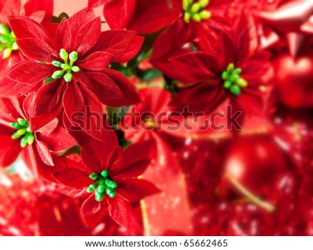 Red Christmas background with various christmas decorations in background. - stock photo