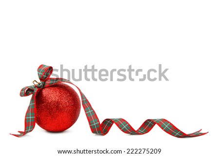 Red Christmas ball and ribbon isolated on white background. - stock photo