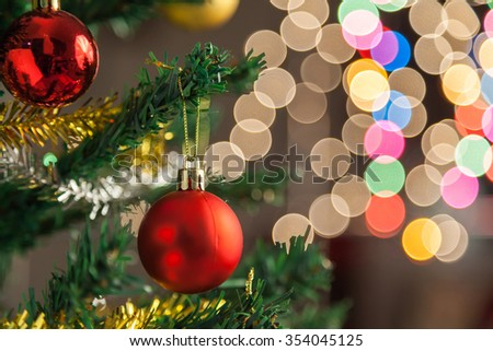 Red christmas ball decoration agains bokeh background - stock photo