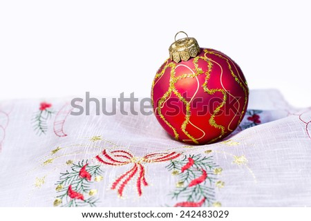 Red Christmas ball embroidered napkin isolated on white background - stock photo
