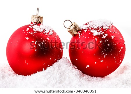 red Christmas ball in the snow - stock photo