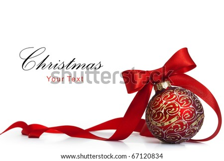 Red Christmas ball on a glossy surface - stock photo
