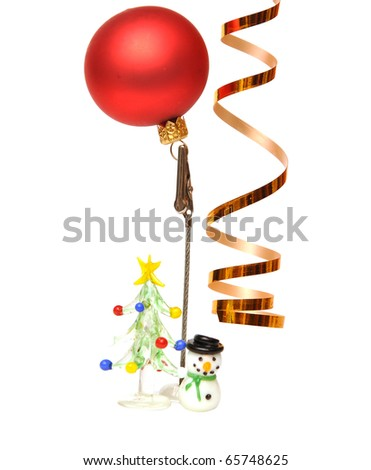 Red Christmas ball on a small stand for notes