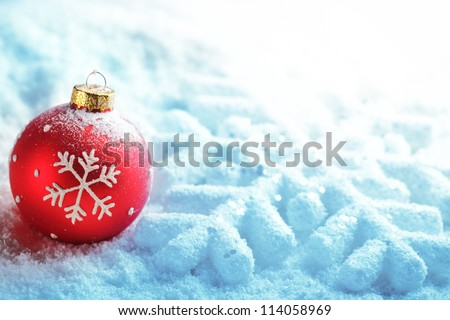 Red christmas ball on snow - stock photo