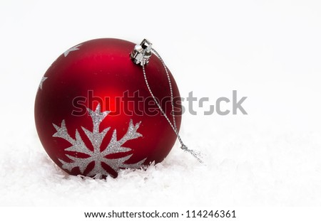 Red Christmas ball ornament with silver stars on white - stock photo