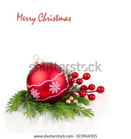 Red Christmas ball, red berries and branches of a Christmas tree on a white background. A Christmas background with a place for the text.