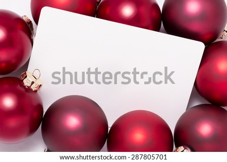 Red Christmas ball with greeting card which has space for text