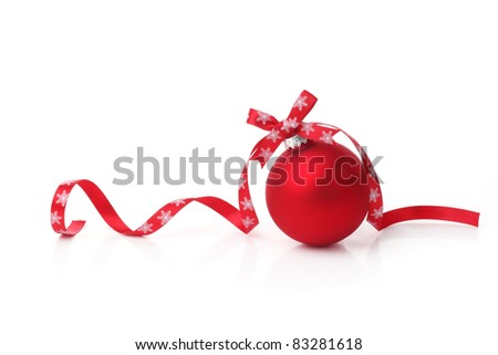 Red christmas ball with ribbon bow on white background. - stock photo