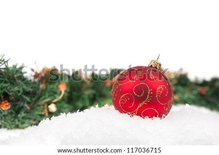 Red christmas ball with snow on white background - stock photo