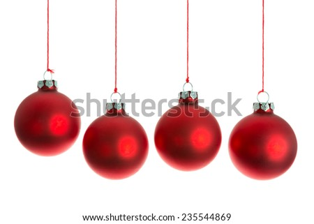 Red Christmas balls hanging at a rope over white - stock photo