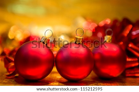 Red Christmas balls on a gold background - stock photo