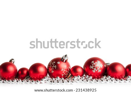 red christmas balls on white. studio shot - stock photo