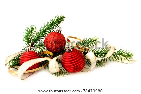 Red Christmas balls, ribbon and green branch on white background - stock photo
