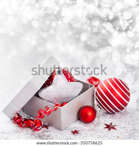 Red Christmas balls, silver star and gift box and on white background - stock photo
