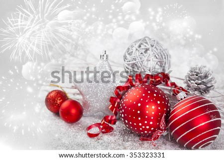 Red Christmas balls, silver star and gift box on sparkling holiday background - stock photo