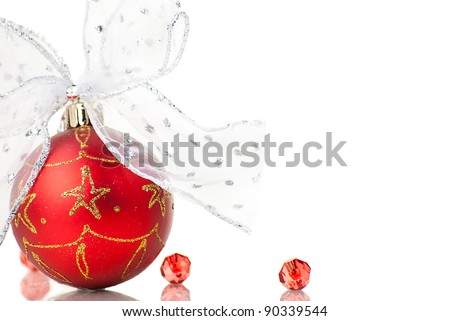 Red Christmas balls with bows on white background - stock photo