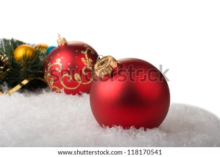 red christmas balls with branch christmas tree on snow