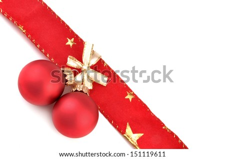 red christmas balls with ribbon over white background
