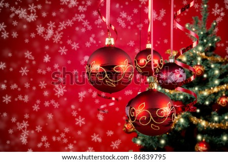 Red christmas balls with snow flakes on background - stock photo